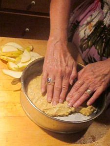 Spread the cake batter with your fingers.