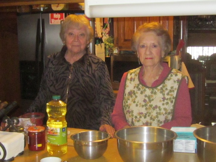 Elda Islas and Armida Islas as sisters-in-law who make Sonoran flat enchiladas according to directions handed down by Elda's mother and their mother-in-law Josefa.