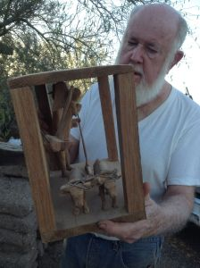 NW Mexico craft-arts collector and expert Dr.Barney T.Burns with santo of SanYsidro showing the oxen and angels.