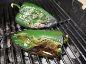 These chiles are charred on one side. I have turned them to blacken another side.