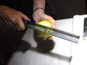 Using a microplane to make lemon zest.