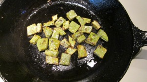 The cooked nopalitos turn from bright green to olive.