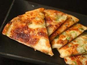 Savory pancakes using onion tops.