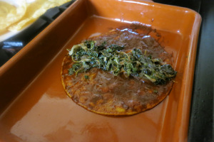 Dip the tortilla in chile sauce, add some purslane and roll.