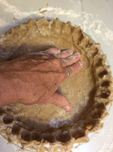Pressing mesquite/whiteSonora wheat dough into pie pan