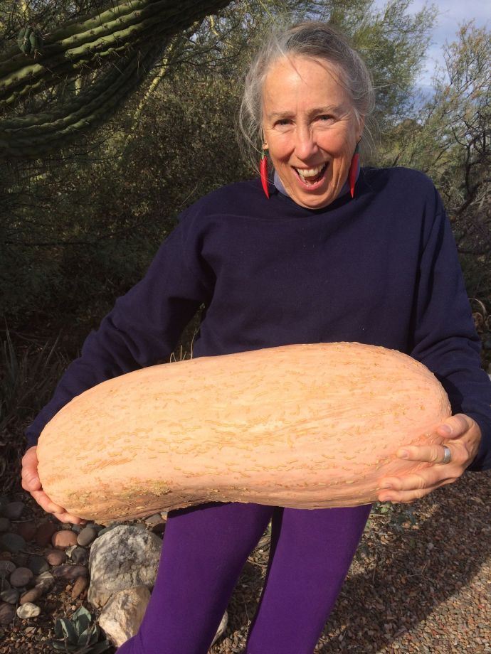 Just for scale, Tia Mart hefts this heirloom Navajo squash. Who needs a workout center if you are a gardener or farmer?