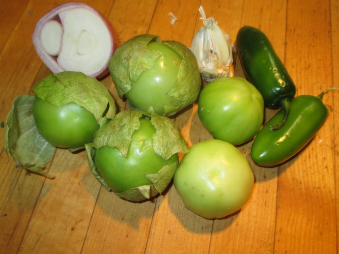 Here are the vegetables you will use: tomatillos, onion, garlic and jalapenos.